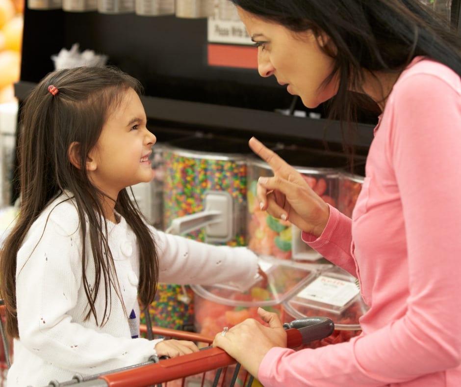 mother reprimanding child in store